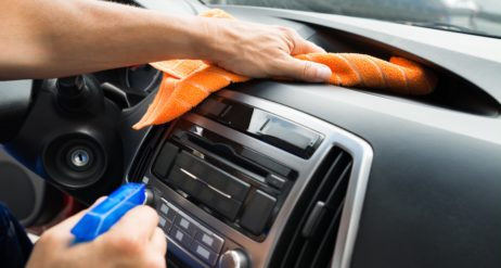 Cleaning Dash With Spray Bottle And Rag